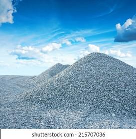 pile of granite gravel on background of the sky
