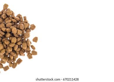 Pile of granulated animal feeds on white background. Studio Photo