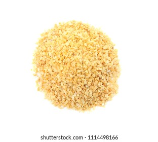 Pile of granulated dry garlic on white background, top view