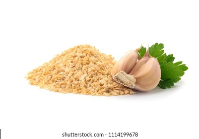 Pile of granulated dry garlic and parsley on white background