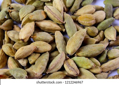 Pile of green cardamon seeds isolated on the white background, Indian or pakistani green elaichi.