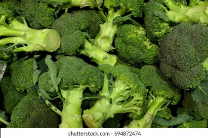 Pile of Green Fresh Broccoli on display for sale at local supermarket,Heaps of Healthy Green Organic Raw Broccoli Florets,Close Up Branch of Broccoli for Background,Top View of Green Fresh Broccoli