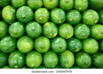 Pile of green limes at farmers market or grocery store