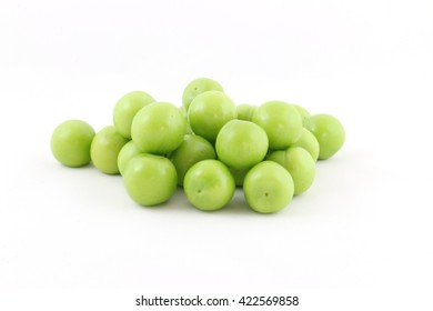 pile of green plums isolated on a white background
