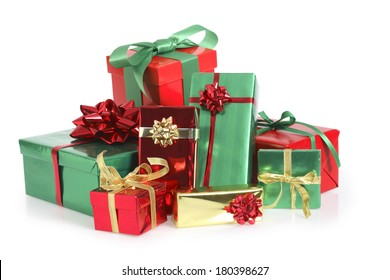 Pile of green, red, and gold Christmas presents on white background