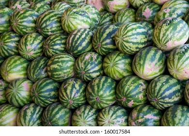 Pile of green watermelons at a fruit market