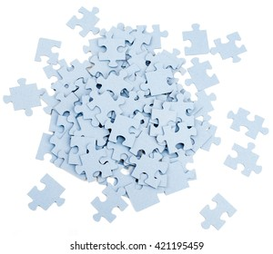Pile of grey blank puzzle pieces isolated on white background, top view