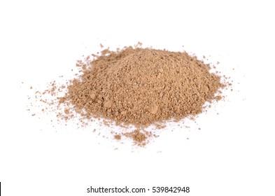pile of ground nutmeg powder on white background