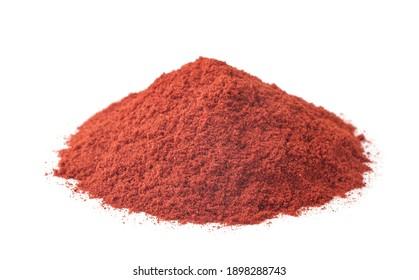 Pile of ground paprika isolated on white