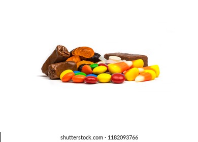 Pile of Halloween Candy Corn Smarties Rockets Chocolate Gummy Works Tootsie Roll