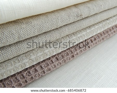 ad4f73c61c9 Pile of handmade dull-colored waffle linen cotton napkins towels on white  linen background. Different colours. Food photo props. Natural waffle linen  cotton ...
