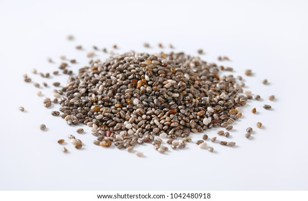 pile of healthy chia seeds on white background