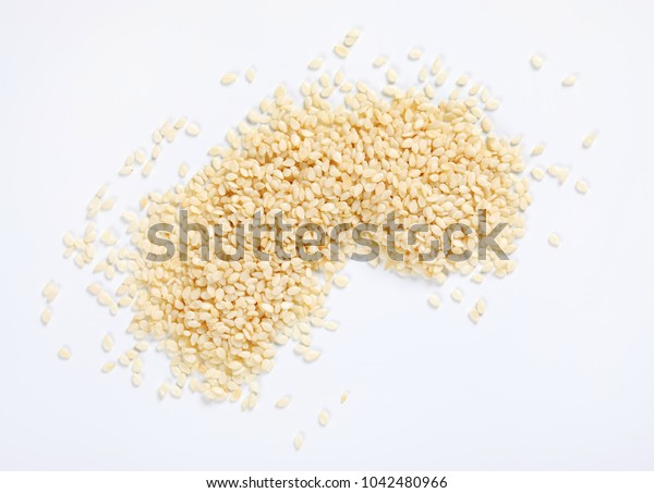pile of healthy sesame seeds on white background
