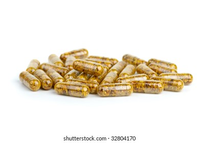 Pile of homeopathic pills with bee pollen isolated on the white background