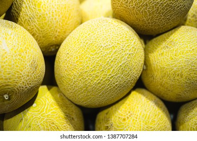 A pile of honeydew melon on display