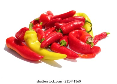 A pile of Hot Peppers of different types in Red and Yellow, isolated on white with room for your text. Hot Peppers are filled with vitamins and chemicals used by people and industries around the world