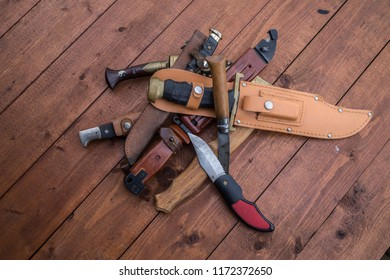 a pile of hunting knives on a table