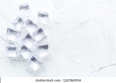 pile of ice cubes on marble bar table top view mock-up
