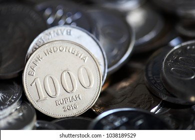 Pile of Indonesian rupiah coins close up