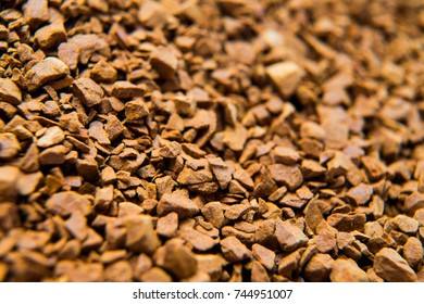 Pile of instant coffee grains background close up