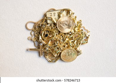 Pile of jewelry in yellow gold