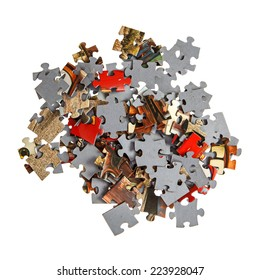Pile of jigsaw pieces isolated over white