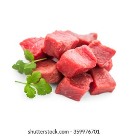 Pile of juicy beef cubes, macro, soft focus, top view