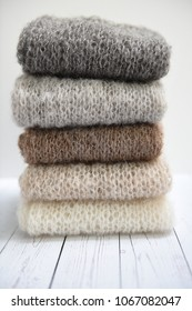 Pile of knit mohair clothes