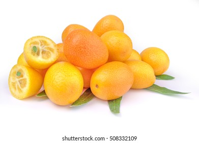 Pile of kumquat and two its half isolated on white background cutout.