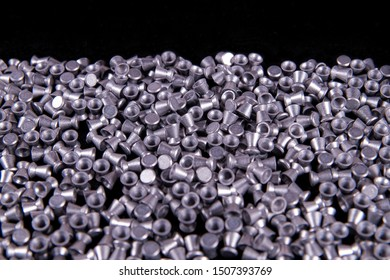 Pile lead pellets for air rifle isolated on black background. air gun pellets for training.