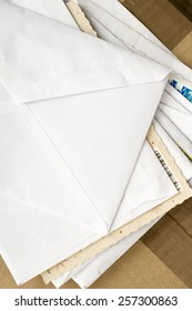 a pile of letters and postal parcel