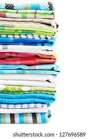 Pile of linen kitchen towels isolated on white background