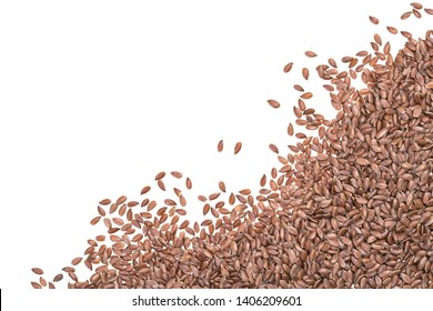 Pile of linseeds or flax seeds spread from lower right corner and isolated on white background