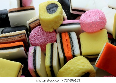 Pile of liquorice allsorts in different shapes, colors and sizes