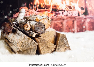Pile of logs near fireplace. Christmas magical atmosphere. Holiday concept