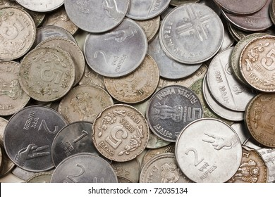 A pile of loose change (rupees).