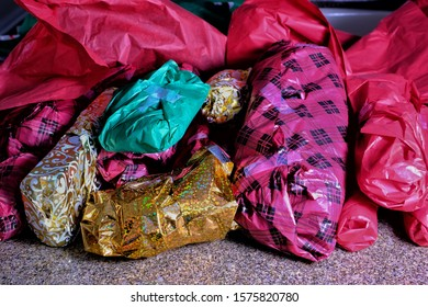 Pile of loosely wrapped small gifts for Christmas stocking stuffers