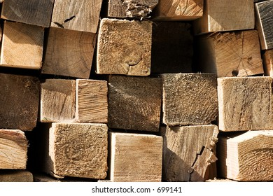 Pile of lumber from the cross section.  Building material at a construction site