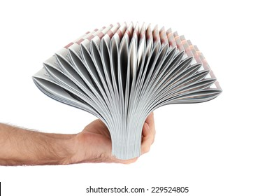 Pile of magazines in hand isolated over white background