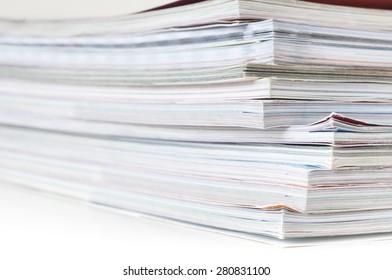 Pile of magazines on white background