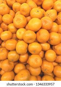 pile of mandarin orange at the market