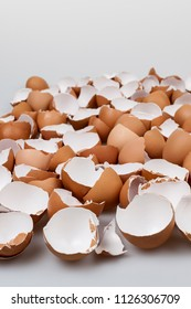 Pile of many broken brown empty eggshells