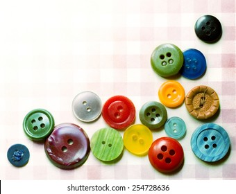 Pile of many coloured buttons as wallpaper