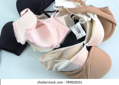 pile of many and different bra on white background