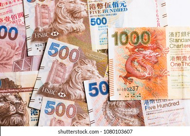 Pile of many Hong Kong Dollar banknotes as money background.