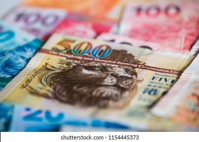 Pile of many Hong Kong Dollar banknotes as money background.