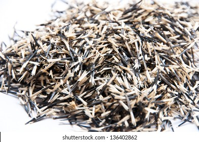 A pile of marigold seeds is ready to plant in a spring garden.
