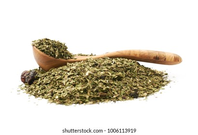 Pile of mate tea leaves with the wooden serving spoon over it, composition isolated over the white background