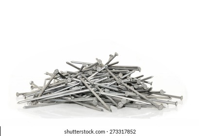 Pile Of Metal Nails In Gray On A White Background