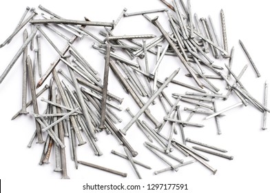 Pile of metal nails on white background.